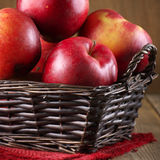 Red apples in basket Stock Image