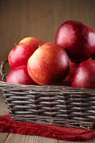 Red apples in basket Stock Photos