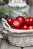 Red apples in basket. Traditional christmas setting. Stock Image