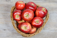 Red apples in a basket wicker Royalty Free Stock Photography