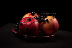 Red apples on a black background. In a photographic studio Stock Image