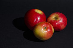 Red apples on black background Stock Images