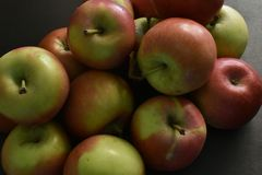 Red apples on black background. royalty free stock images