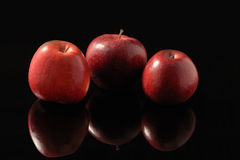 Red apples on a black background Stock Image