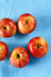 Red apples on the blue Stock Photography
