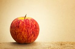 Red apples and blue label put on wooden with paper background Royalty Free Stock Image