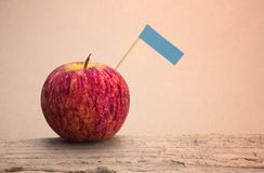 Red apples and blue label put on wooden with paper Royalty Free Stock Photo