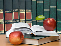 Red apples and  book Stock Images
