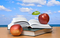 Red apples and  books Royalty Free Stock Photos