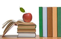 Red apples and books Stock Image