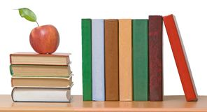 Red apples and books Royalty Free Stock Image