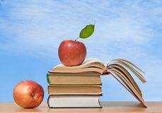 Red apples and books Stock Photography