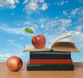Red apples and  books Stock Images
