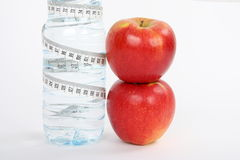 Red apples and bottle of water Stock Photos