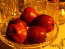 Red apples in bowl. Red conserved appeles in crystal bowl for christmas decor stock photo