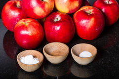Red apples with bowls of spice Stock Photography