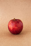 Red apples on brown paper background. Red apples on brown paper Stock Photo
