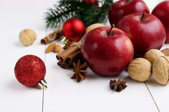 Red apples with christmas spices decoration. On white background Royalty Free Stock Photos
