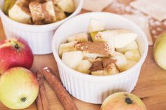 Red apples, cinnamon for apple pie Stock Photos