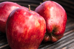 Red apples close up. Closeup of red apples in wooden tray Royalty Free Stock Images