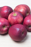 Red Apples closeup shoot. Red apple on wooden background Stock Photos