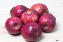 Red Apples closeup shoot. Red apple on wooden background Stock Image