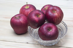Red Apples closeup shoot. Red apples on wooden background Royalty Free Stock Photos