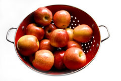 Red apples in colander Stock Photo