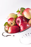 Red apples in a colander Stock Photos