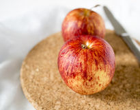 Red apples on a cork mat Stock Photos