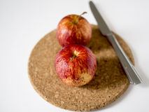 Red apples on a cork mat. Two red apples on cork mat Stock Photo