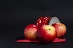 Red apples with cup on black background Royalty Free Stock Photo