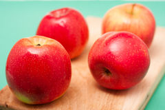 Red apples on cut board Royalty Free Stock Photo