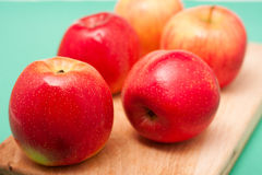 Red apples on cut board Stock Photography