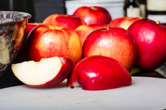 Red apples cut and cored Royalty Free Stock Images