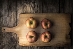 Red apples on a cutting board Royalty Free Stock Images