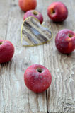 Red apples and decorative heart (Heart Shape) Royalty Free Stock Images