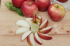 Red apples is delicious on wood background. Stock Photos