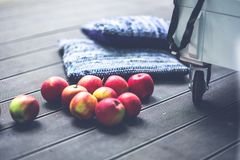 Red apples on the floor Royalty Free Stock Image