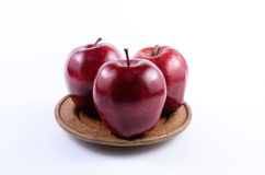 Red apples. Fresh red apples on wooden dish stock image