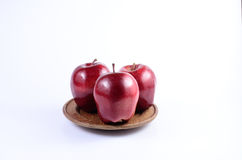Red apples. Fresh red apples on wooden dish royalty free stock images