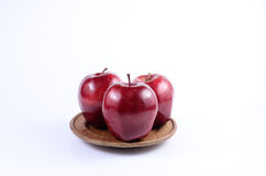 Red apples. Fresh red apples on wooden dish stock photography