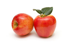 Red apples fruit with leafs on white background Stock Images