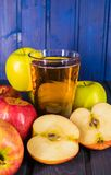 Red apples and glas of apple juice. Close up shot of fresh juicy red apples royalty free stock images