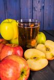 Red apples and glas of apple juice stock images