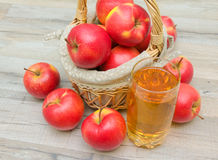 Red apples and glass of apple juice Royalty Free Stock Images