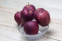 Red apples in a glass bowls. Closeup shot of fresh red apples stock image