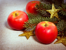 Red apples, gold stars and spruce branches Royalty Free Stock Photos