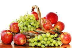 Red apples and grapes Stock Photography