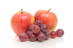 Red apples and grapes on a white background Stock Photo